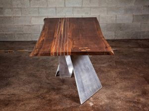 La Portée Black Walnut Dining Room Table with aluminum inserts