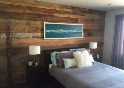 Large bedroom wall in brown barn wood