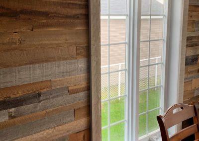 Living room wall of mixed barn wood (brown | gray)