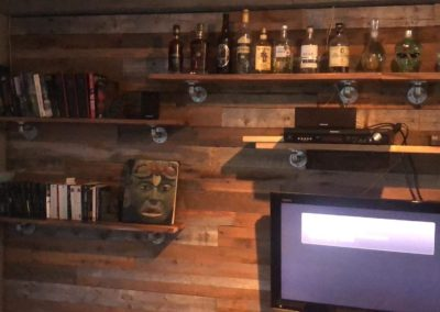 Mixed barn wood wall (brown and gray) with bottles